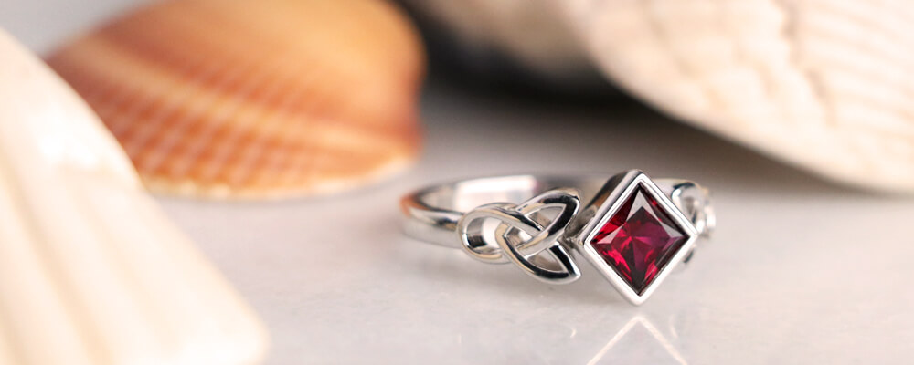 Trinity Knot Ring with a Kite Set Ruby