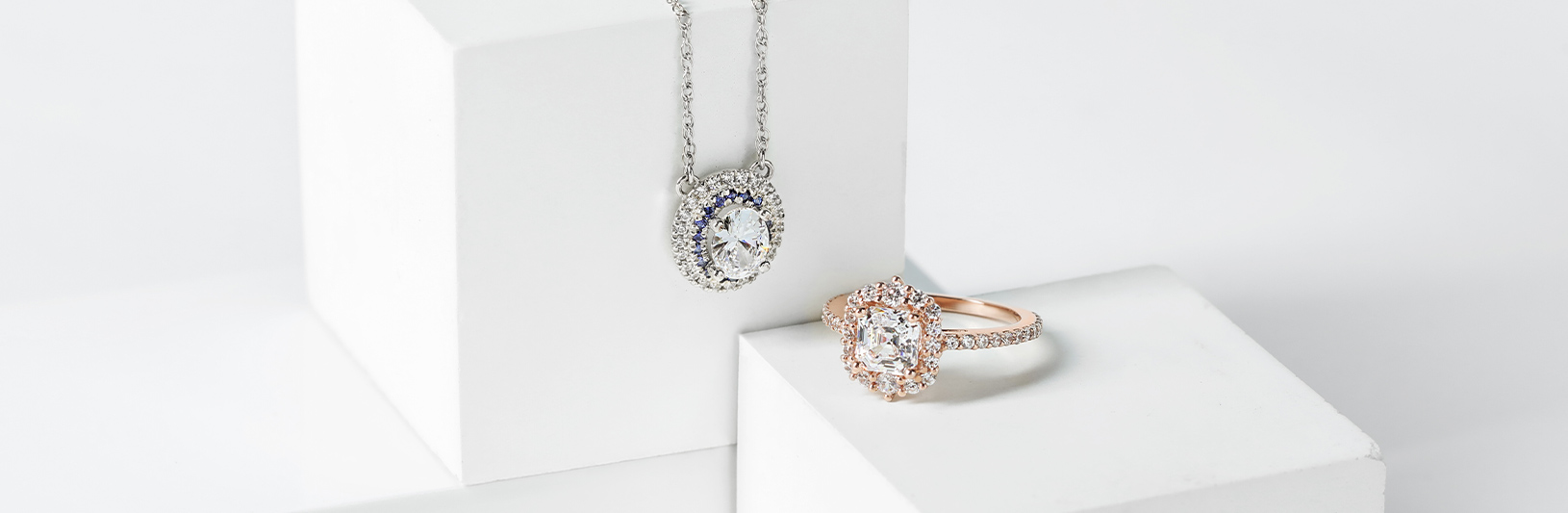 A necklace and engagement ring with vintage design elements
