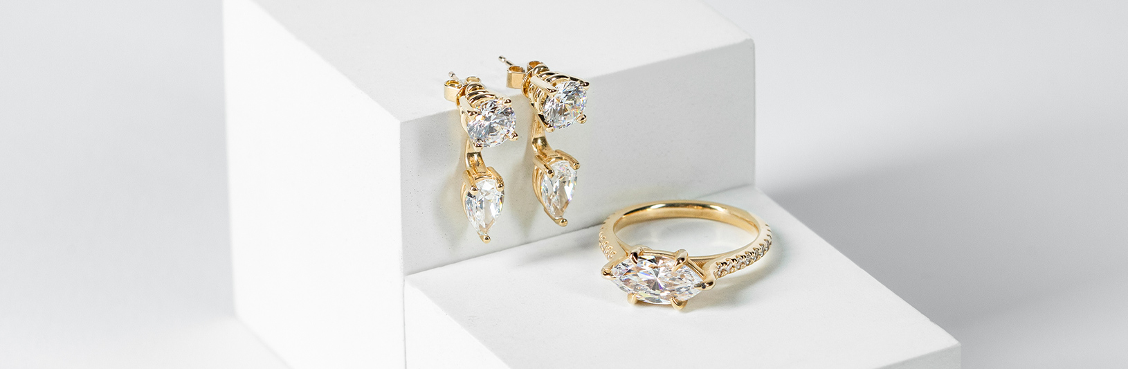 Yellow gold drop earrings and a yellow gold ring with a marquise stone