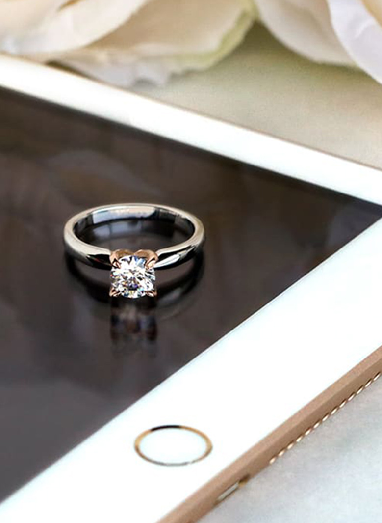 A round cut lab grown diamond engagement ring
